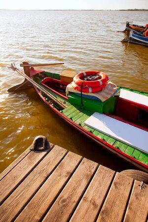 Albufera lake traditional boats in Valencia Spain photo