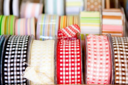 haberdashery: fabric tapes reels in haberdashery of vichy squares Stock Photo