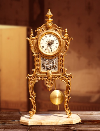 grandfather clock: ancient vintage brass pendulum clock in old house interior