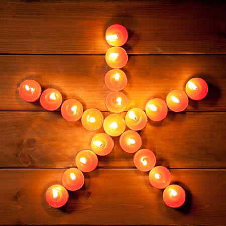 christmas candles pentagram star on golden warm wood photo