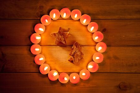 christmas candles circle over wood and tree star symbol photo