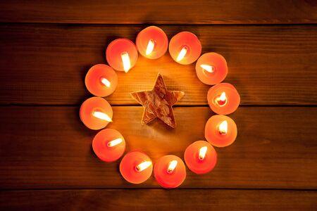 christmas candles circle over wood and bark star symbol photo