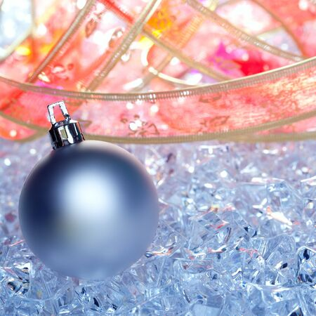 christmas baubles silver on winter ice with star symbol and ribbon photo