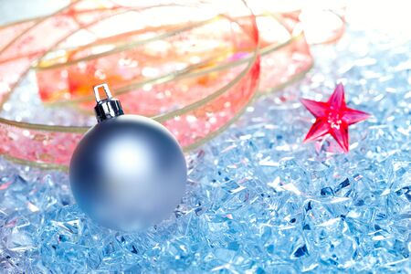 christmas baubles silver on winter ice with star symbol and ribbon Stock Photo - 10743016