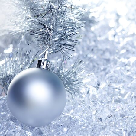 christmas baubles silver on winter ice with star symbol shapes photo