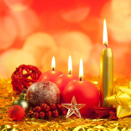 christmas red candles on golden bokeh lights background Stock Photo - 10743173