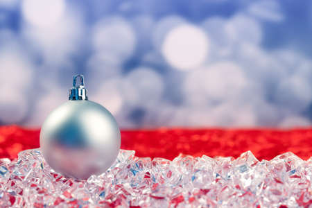 Christmas silver bauble on ice cubes with blue lights bokeh background Stock Photo - 10743027