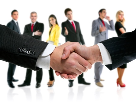 company manager: business people handshake with company team in background Stock Photo