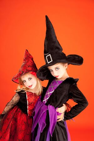 Halloween sister kid girls on orange background