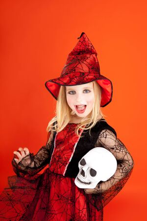 Halloween kid girl costume on orange background Stock Photo - 10838171