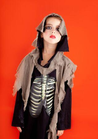 Halloween kid girl costume on orange background photo
