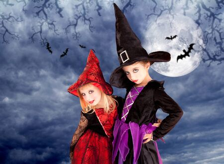 halloween costumes kid girls on moon night sky with bats photo