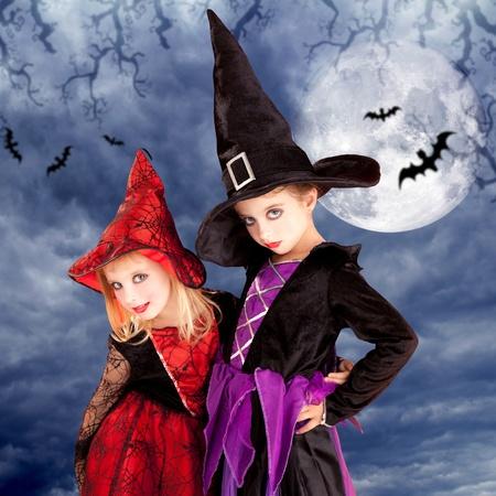 halloween costumes kid girls on moon night sky with bats photo
