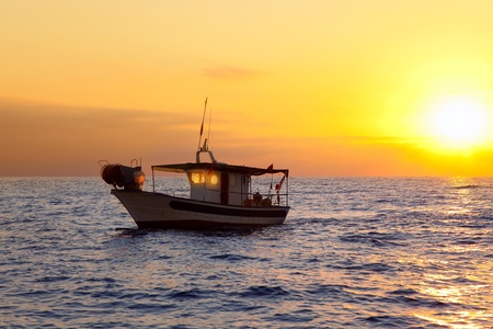 mediterranean sea: fishing boat in sunrise at Mediterranean sea traditional fishery Stock Photo