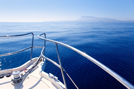 recreation yachts: Boat bow sailing in blue Mediterranean sea in summer vacation Stock Photo