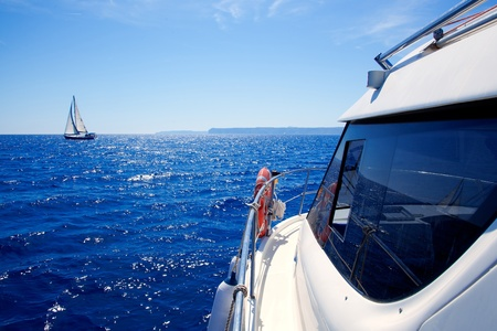 boat side view of blue ocean with sailboat in Mediterranean sea photo