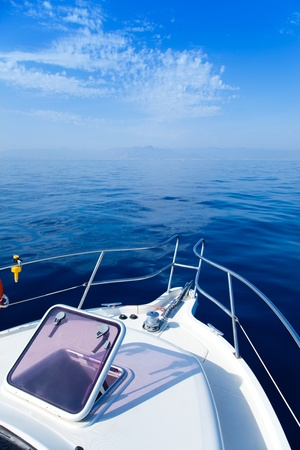 Blue sea boat sailing with open bow porthole in summer vacations photo