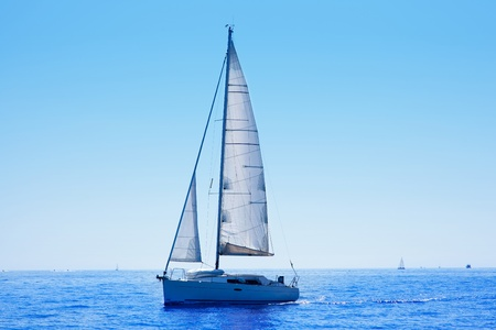 speed boat: blue sailboat sailing mediterranean sea with water horizon