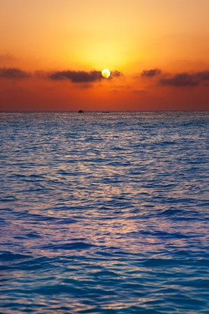 Mediterranean sea sunrise sunset with sun in orange sky photo