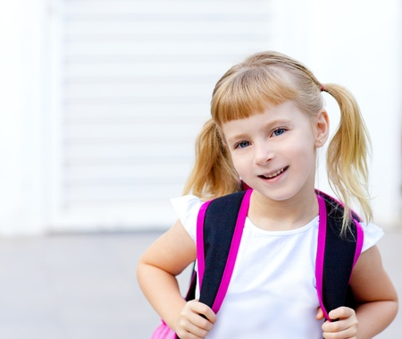 pigtail: children little girl with pigtails going to school with backpack Stock Photo