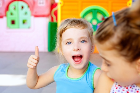 children happy little sister girls with ok hand gesture photo