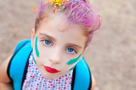 blue eyes  children girl  painted face makeup in outdoor party photo