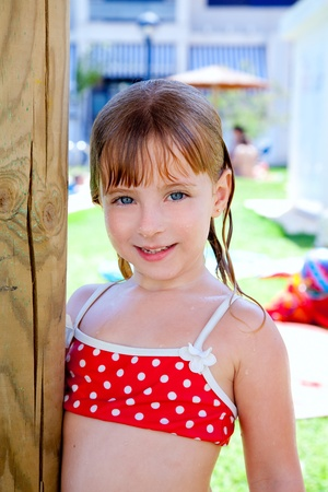human kind: bikini kid girl water wet in pool garden holding sunroof pole