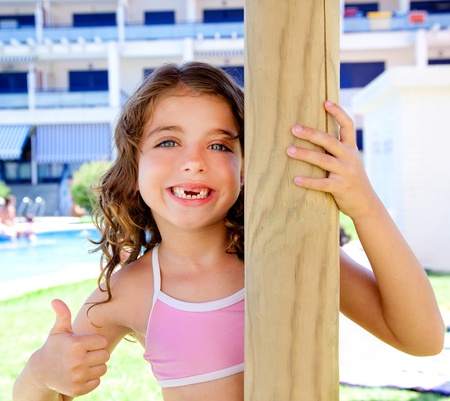 human kind: indented kid girl ok gesture in pool garden holding sunroof pole