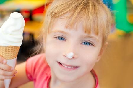 eye cream: children girl happy with cone icecream smiling
