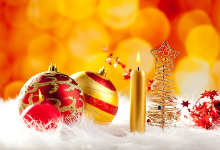 christmas wire tree with candle and baubles in blurred lights background photo