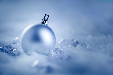 christmas baubles of modern design: christmas silver bauble on fur snow and ice cold winter