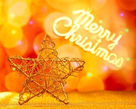 Golden star with Merry Christmas written in lights background photo