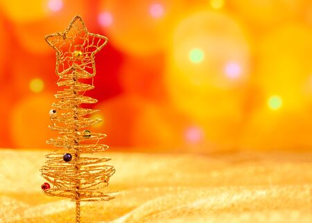 Christmas golden wire tree in blurred lights background photo