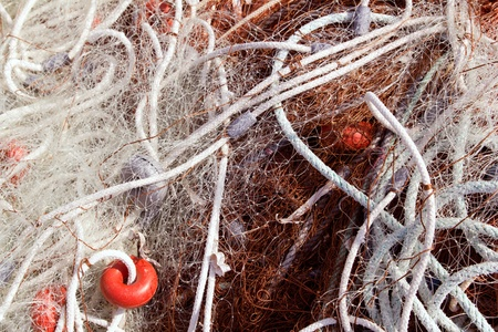 fishing nets and buoys tackle for professional mediterranean fisherboat photo
