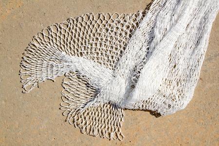 fishing new white net texture closeup in Mediterranean port photo