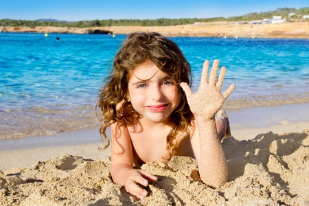 Little girl greeting hand gesture in sandy beach of Ibiza Cala Conta Stock Photo - 11058220