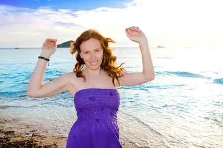 chillout: Dancing girl at Ibiza sunset in Cala Conta of San Antonio chillout