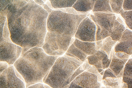 beach sand bottom ripple of water waves reflection texture Stock Photo