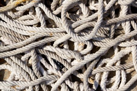 messy braided ropes of fishing tackle equipment photo