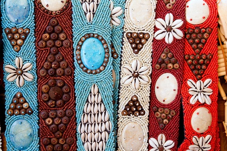 craftsmanship: colorful handcrafted belts with sea shells in Balearic islands