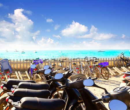 bikes and motorbikes parking in Illetes beach at Formentera island