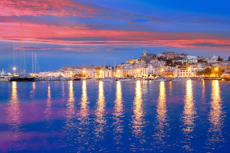 Ibiza island night view of Eivissa town and sea lights reflection
