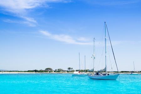 anchored: anchored sailboats in turquoise Formentera Illetes beach near Ibiza