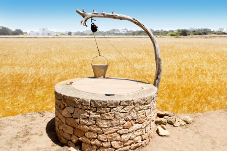 water well: Draw well traditional mediterranean masonry in balearic islands