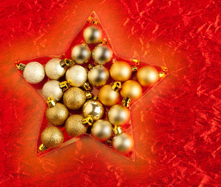christmas baubles in star shape on red background photo