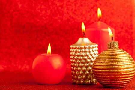 christmas candles group on red glitter background photo