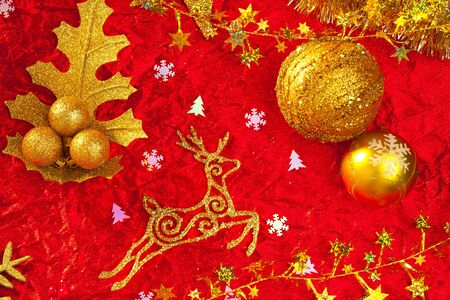 Christmas card background golden and red with baubles stars santa reindeer photo