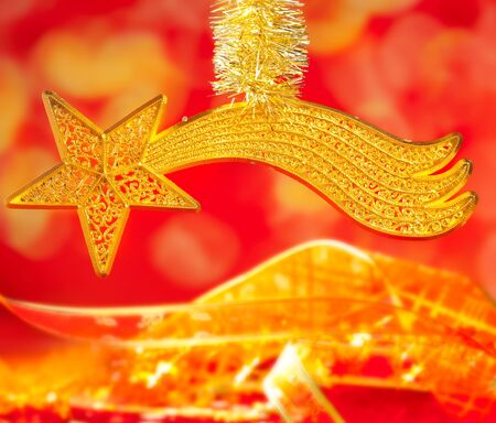 Christmas card bethlehem comet gold star on red blur background photo