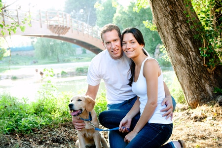 man dog: beautiful couple with puppy