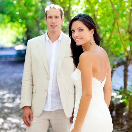 bride just married couple in love at outdoor green park